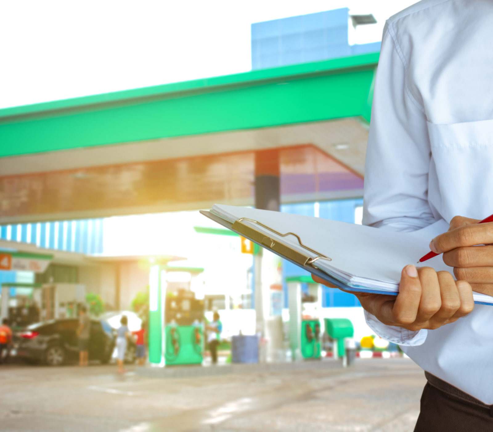Man staff oil or gas station writing on notrpad using energy for car or transportation, 